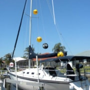 scare eyes balloon hanging on sailboat mast